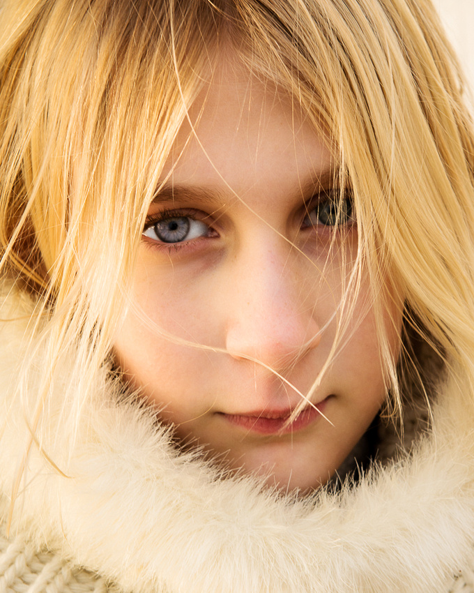 Portrait of girl in natural, soft winter sunlight.  Taken on Shoreham Beach, Shoreham-by-Sea, West Sussex.  Photo by Jenny Rutterford Photography