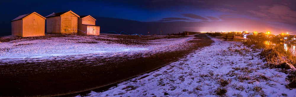 Long exposure of Shoreham-by-Sea coastal path at dusk, lit by torchlight of an evening runner.  Panoramic by Jenny Rutterford Photography