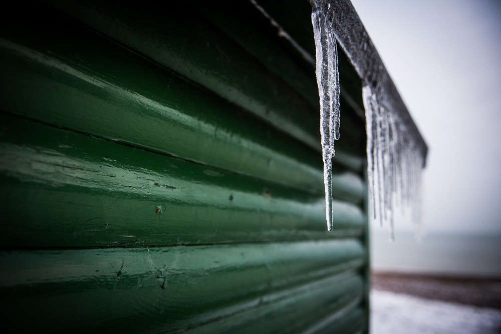 Icicles on beach hut, Shoreham Beach, Shoreham-by-Sea, West Sussex.  Photo by Jenny Rutterford Photography
