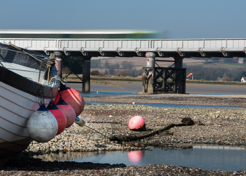 Boat and train, River Adur at low tide, Shoreham-by-Sea, West Sussex.  Photo by Jenny Rutterford Photography