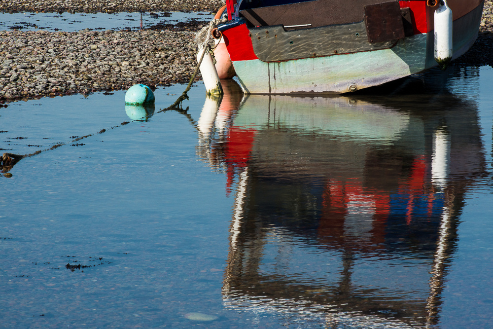 Boat reflected in River Adur at low tide.  Shoreham-by-Sea, West Sussex.  Photo by Jenny Rutterford Photography