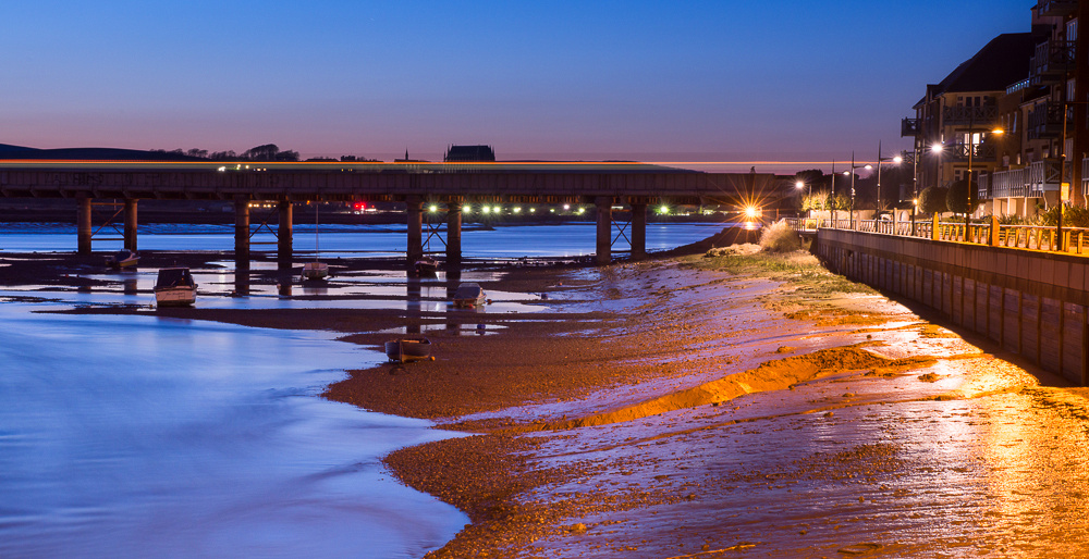 Train passing over the River Adur railway bridge at night.  Ropetackle, Shoreham-by-Sea, West Sussex.  Photo by Jenny Rutterford Photography.