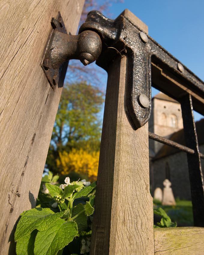 Spring flowers peeping through the gateway to St Nicolas
