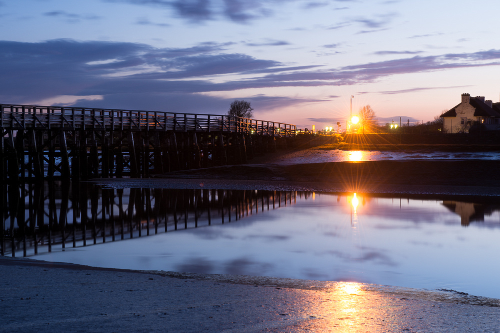 Reflected skies after sundown and views of Old Shoreham Tollbridge over the River Adur, Shoreham-by-Sea.  Photo by Jenny Rutterford Photography.