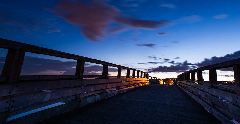 Crossing the River Adur after sundown.  Old Shoreham Tollbridge, Shoreham-by-Sea, West Sussex.  Panoramic photo by Jenny Rutterford Photography.