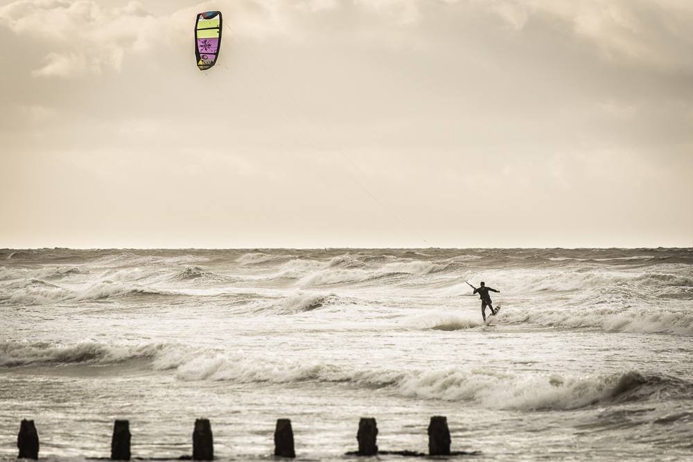 Kite surfer on the waves, daybreak at Shoreham Beach. Shoreham-by-Sea.  Image by Jenny Rutterford Photography.