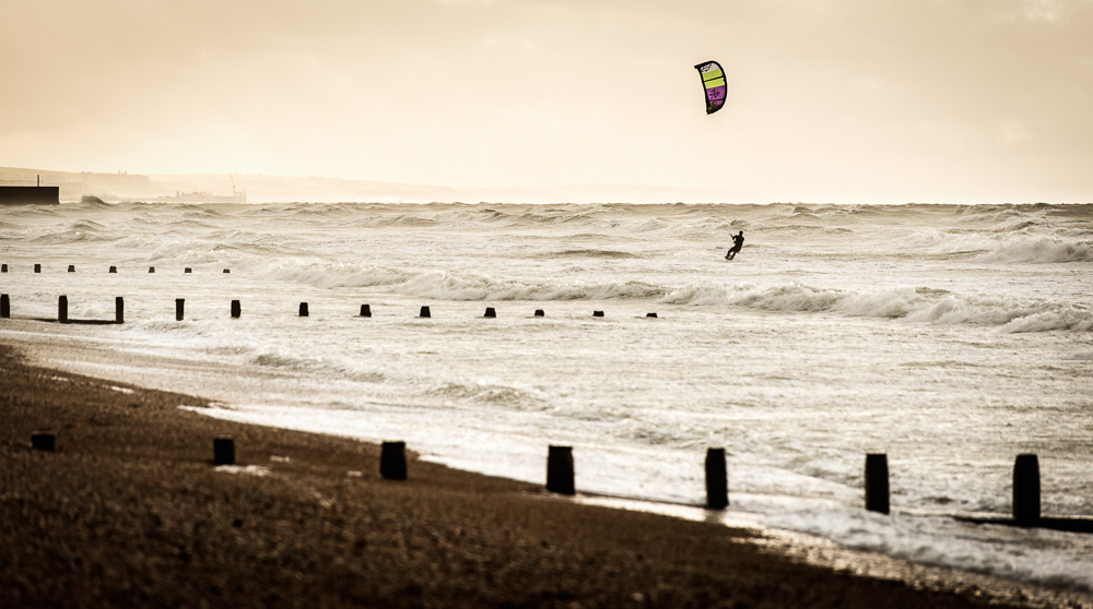 Kite surfer at daybreak, windy morning on Shoreham Beach, Shoreham-by-Sea.  Image by Jenny Rutterford Photography.