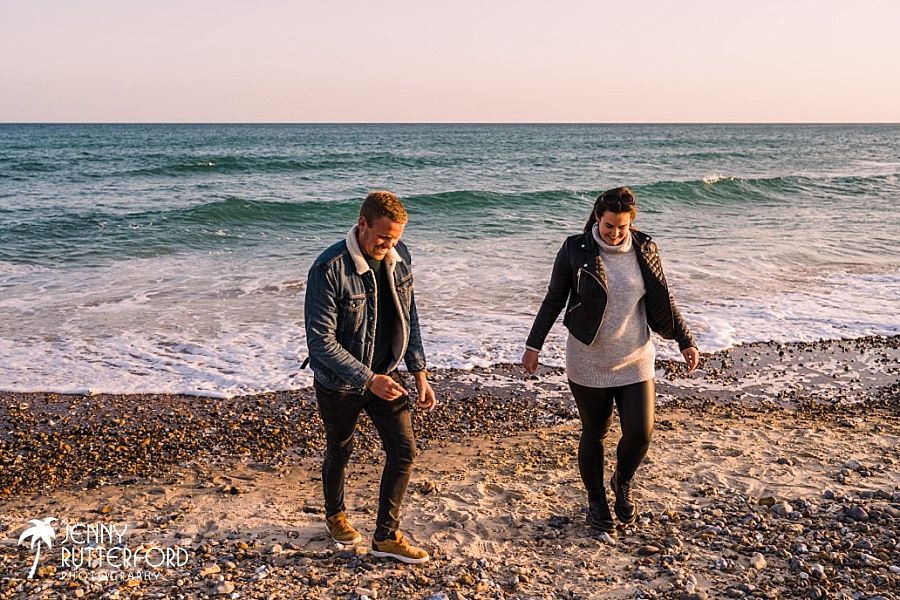Relaxed photo of happy couple on their beach pre-wedding shoot with Jenny Rutterford Photography