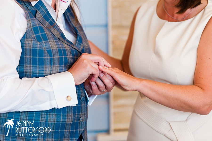 Exchanging rings at Lusty Glaze Beach Wedding