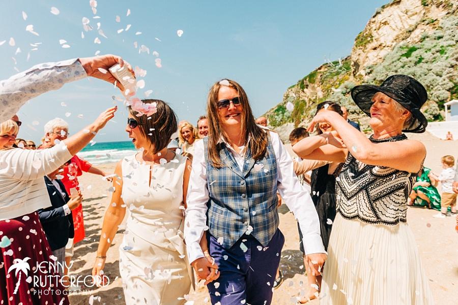 Fab confetti moment at Lusty Glaze Beach Wedding