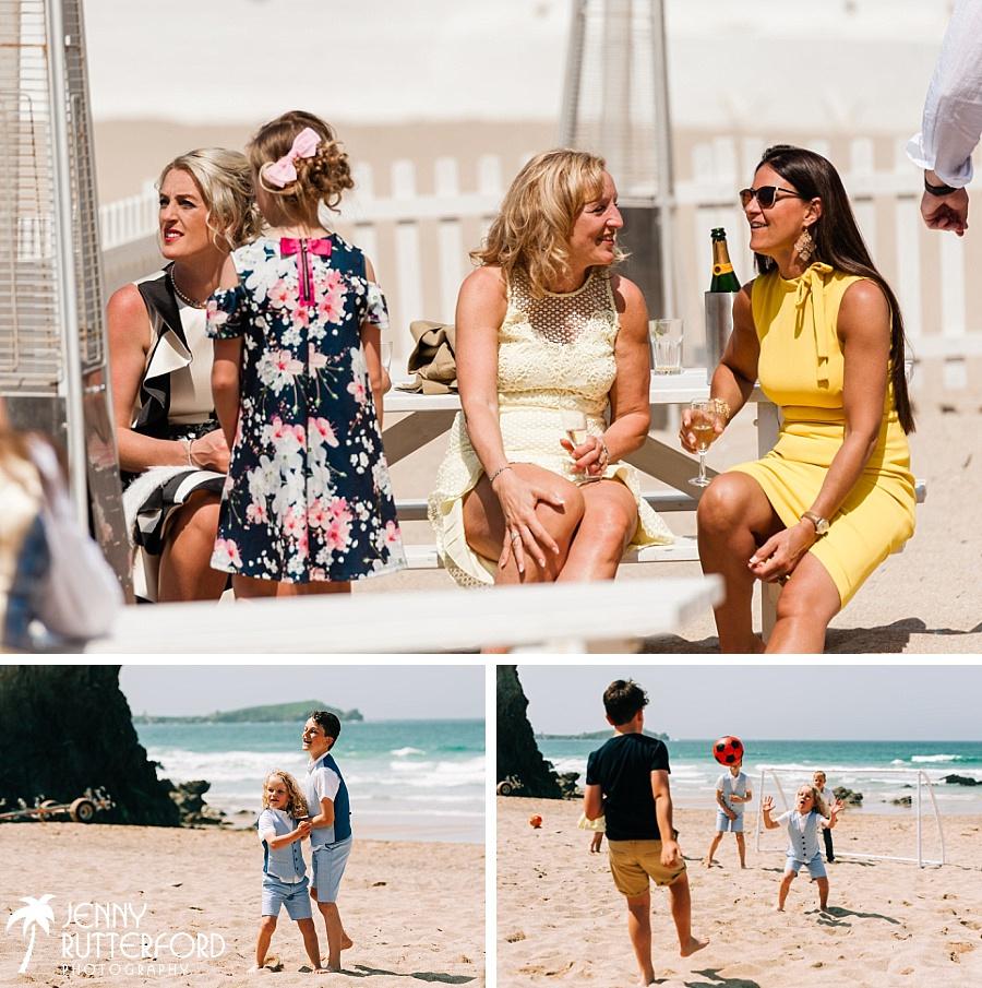 Guests enjoying the sunshine at Lusty Glaze Beach Wedding