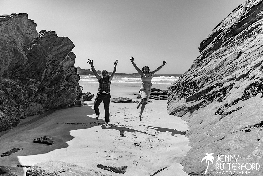 Jumping for joy!  Two brides at their wedding on Lusty Glaze Beach