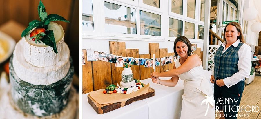 Cutting the cake at Lusty Glaze Beach Wedding