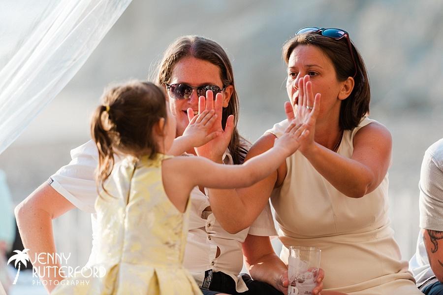 High fives at Lusty Glaze Beach Wedding