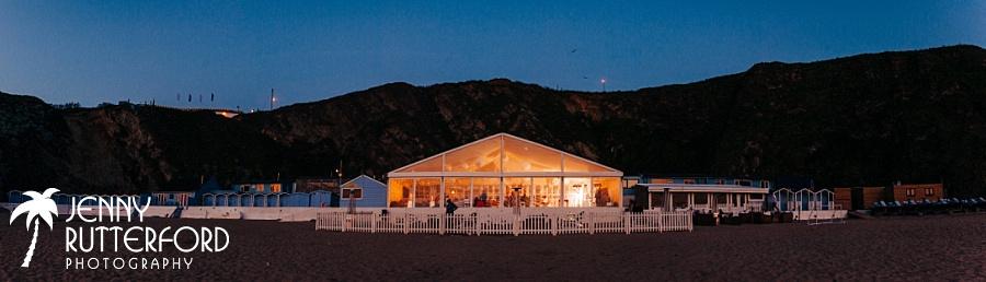 Lusty Glaze Beach Wedding Marquee at night