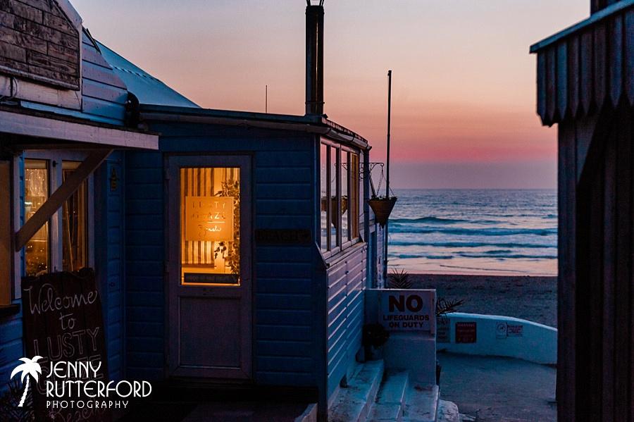 Lusty Glaze Beach Wedding at dusk