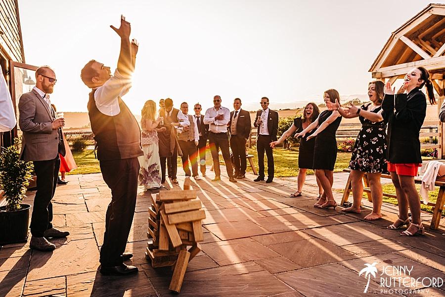 Jenga moment at Long Furlong Barn wedding