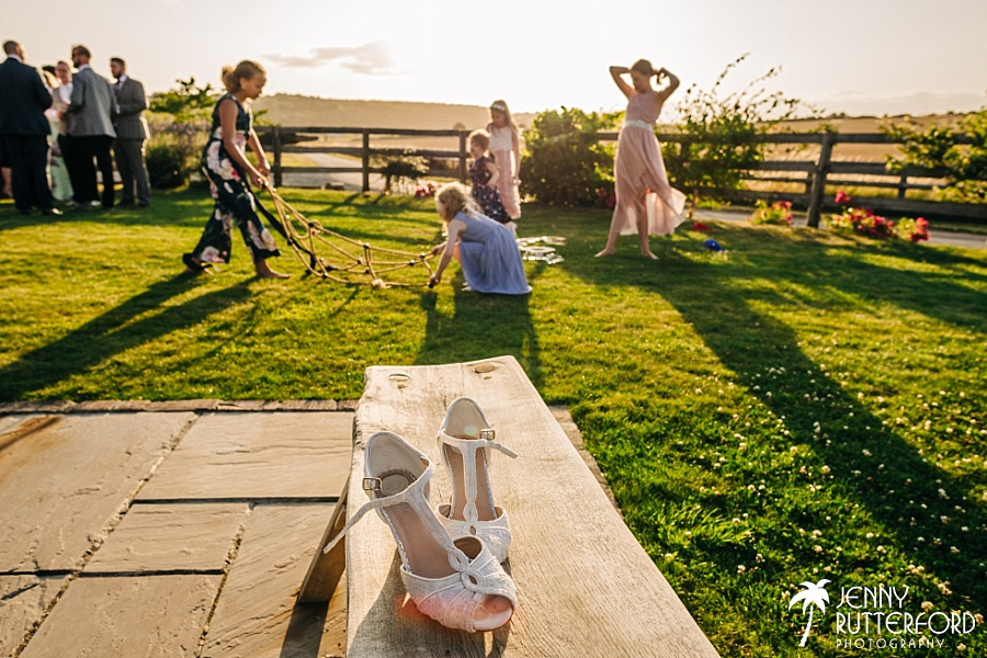 Discarded wedding shoes at Long Furlong Barn
