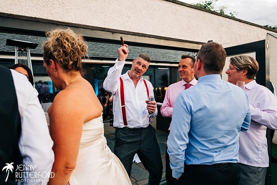 Groom with cigar, Archerfield House Scotland Wedding