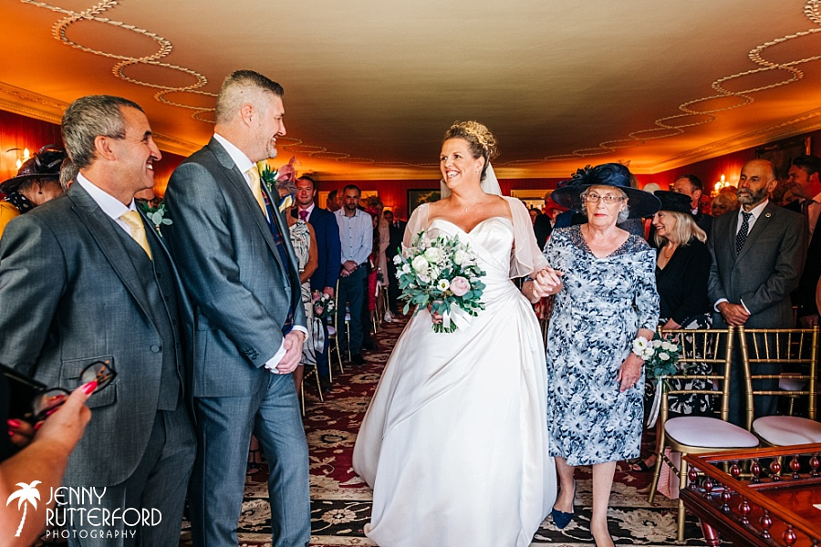 bride walking up the aisle at Archerfield House wedding