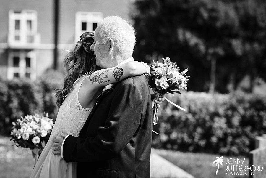 Emotional hug outside church at West Sussex wedding