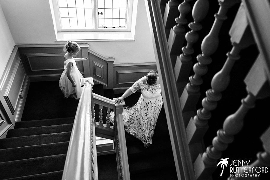Bride and flower girl on stairs at Edes House, Chichester