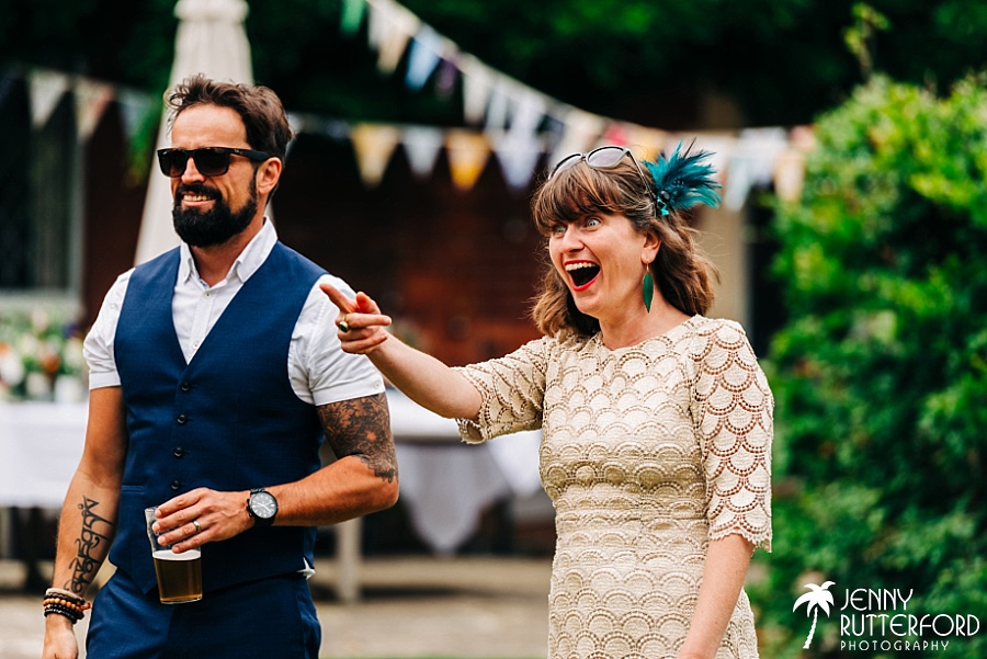 Guest laughing at Chichester picnic wedding