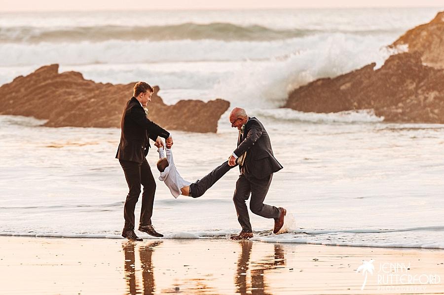 Natural, candid wedding photographer Lusty Glaze Beach