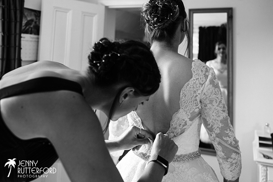 Bride getting into dress Long Furlong Barn wedding