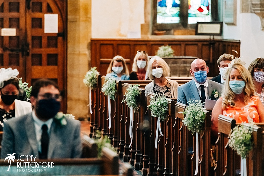 Guests wearing masks at small church wedding in Sussex