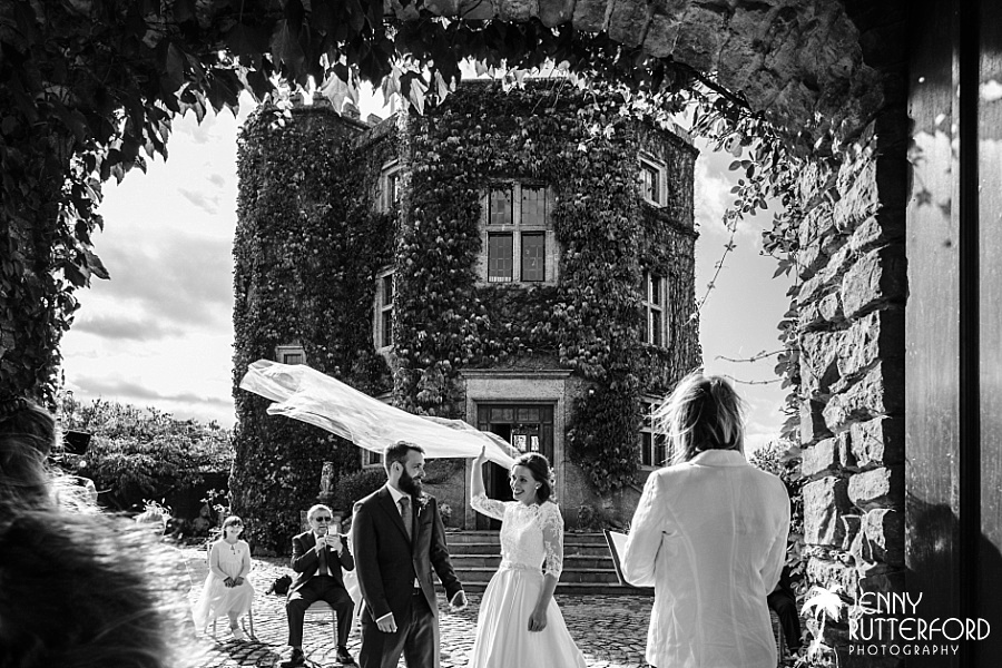 Bride's veil in wind at Walton Castle, small wedding Somerset