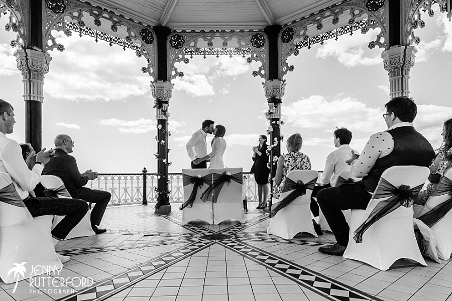 Just married couple kiss at Brighton Bandstand wedding