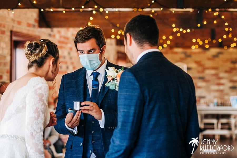 Ring exchange during wedding ceremony at Long Furlong Barn