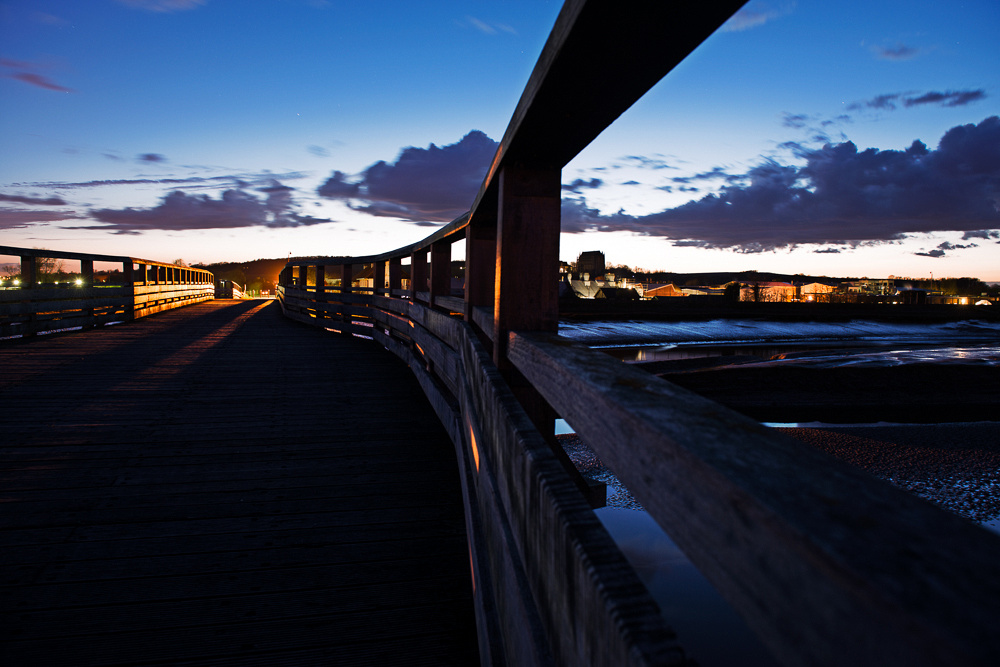 Dramatic perspective of Old Shoreham Tollbridge at dusk.  River Adur, Shoreham-by-Sea, West Sussex.  Image by Jenny Rutterford Photography.