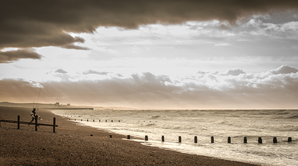 Early morning kite surfer on Shoreham-Beach, Shoreham-by-Sea.  Image by Jenny Rutterford Photography.