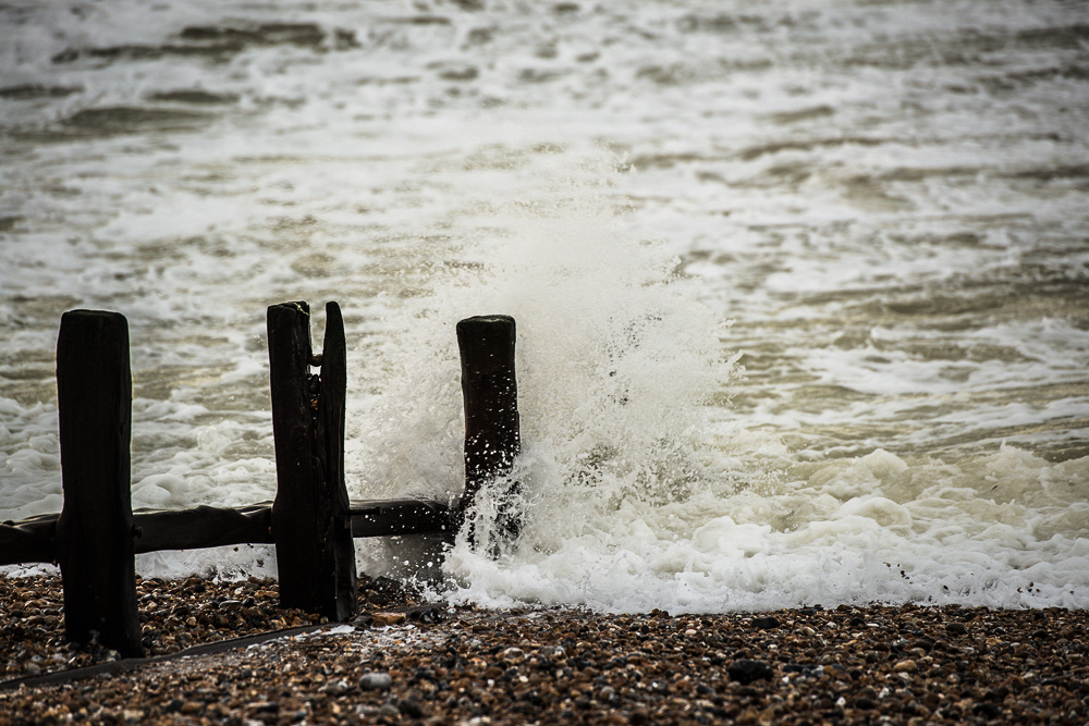 Waves lashing the groynes on a windy morning on Shoreham Beach, Shoreham-by-Sea.  Image by Jenny Rutterford Photography.